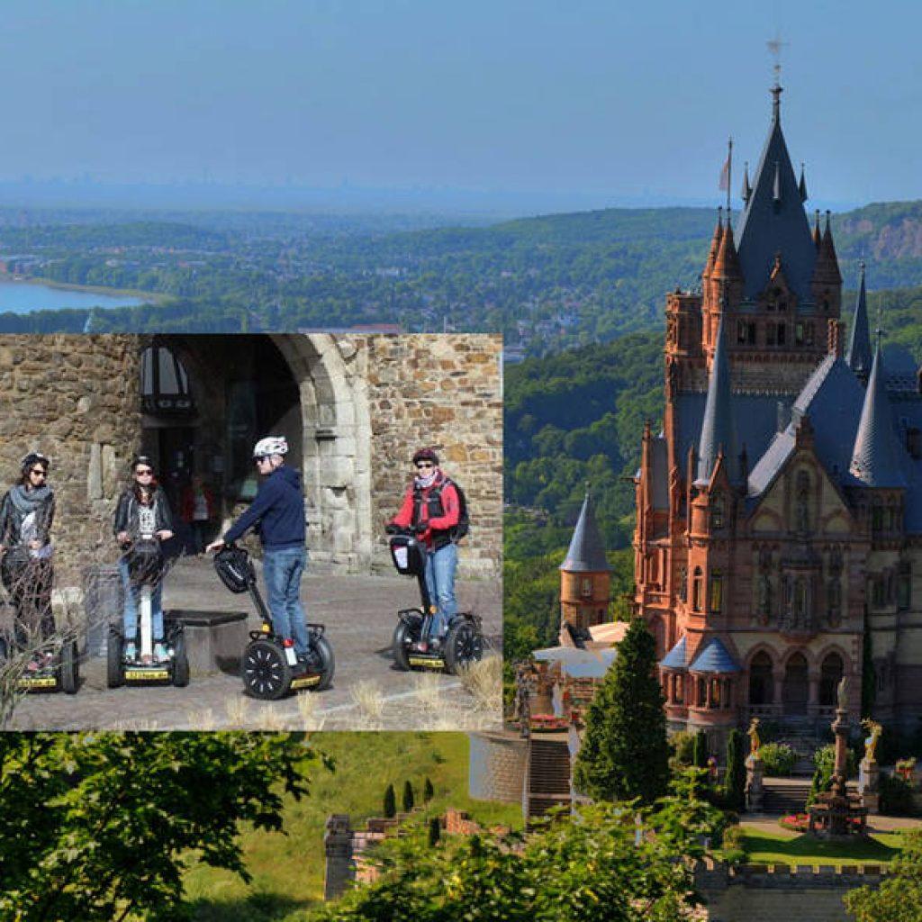 Segwayfahrer vor einer Burg über Bonn
